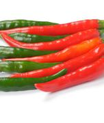 Arrangement of green and red chili peppers Stock Photos