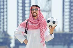 Arab with footbal at seaside Stock Photos