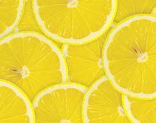 Tiivistelmä tausta sitrushedelmien sitruunan viipaleet. Lähikuva. Kuvituskuvat