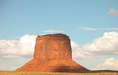 Massive sandstone pillar soar above iconic Monument Valley at su Stock Photos