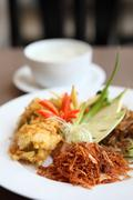 Stock Photo of jusmine rice in iced water such deep fried pork, onion, chili. authentic thai
