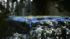Water running in stream close up Stock Footage