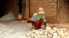 Group of people working in lime kiln, Asia Stock Footage
