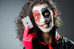 Joker with face mask in studio - stock photo