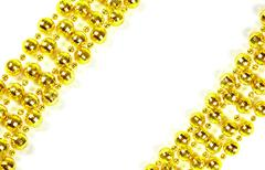 Background made of a brilliant celebratory beads of golden color Stock Photos
