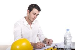 young architect absorbed in work - stock photo