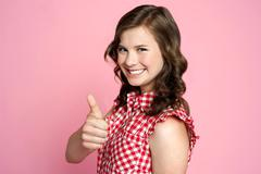 Beautiful smiling girl with ok gesture - stock photo