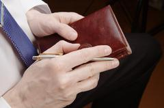 Businessman holding leather wallet Stock Photos