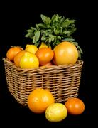 basket with different fruits in season - stock photo