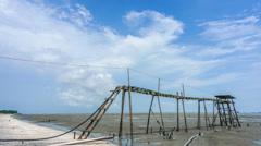 4k cloud timelapse jeram with wooden jetty Stock Footage
