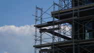 Stock Video Footage of Scaffolding On Building Being Constructed With Clouds Ultra HD Time Lapse