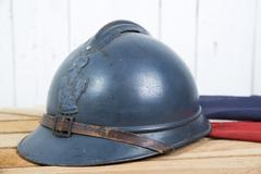french helmet and old french flag - stock photo