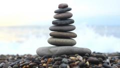 Stack of Stones on the black sea Stock Footage