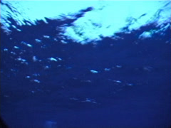 Ocean scenery choppy surface and full moon, drowning POV, on water surface, at - stock footage
