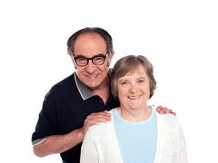 Lovable husband posing along with wife - stock photo