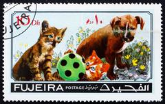 Postage stamp Fujeira 1971 Dog and Cat, Pets - stock photo