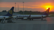 Stock Video Footage of Sunset behind Ryanair fleet (slow motion)