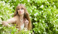 Stock Photo of woman looks out of bushes