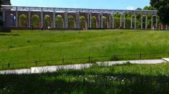 Munich greenery park garden Bicycle Biking Biker jogger Germany Europe Stock Footage