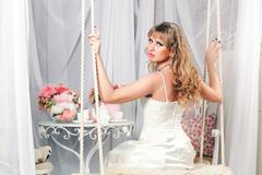 Stock Photo of beautiful woman on a swing