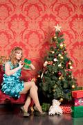 woman near the christmas tree - stock photo