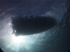 Ocean scenery boat blocks the sun briefly, on boat on the surface, UP6027 Stock Footage