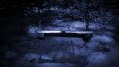 Old empty swing at night. Stock Footage