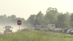 Stormy summer day traffic backup telephoto Stock Footage