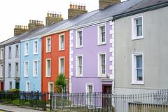 colorful houses with a to let sign - stock photo