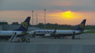 Stock Video Footage of Passengers board plane at sunset timelapse