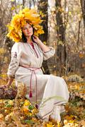 woman in the autumn forest - stock photo