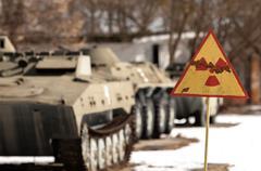 Radiation hazard sign with tanks Stock Photos