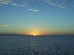 Ocean scenery calm seas, clear sky, on ocean horizon, at sunset, UP7027 Stock Footage
