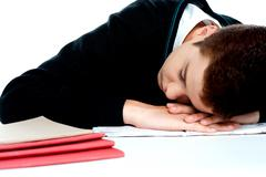 Bored student sleeping during a lecture Stock Photos