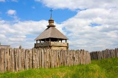 Ukrainian fortress and wooden church - stock photo
