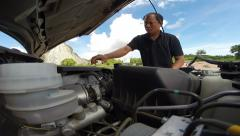 Man to check car engine before driving Stock Footage