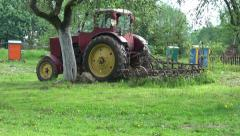Retro tractor and bee beehive in old farm  garden Stock Footage