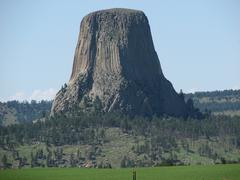 Devils Tower, Wyoming in evening light with blue sky Stock Photos