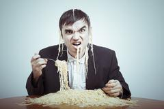 Greedy consumerism Stock Photos