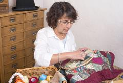Mature woman by sewing and quilting Stock Photos