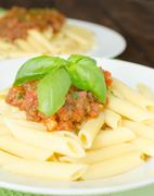 penne with bolognese sauce - stock photo