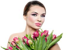 Beautiful smiling woman with tulips Stock Photos