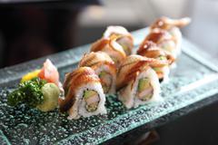 Eel and avocado maki sushi Stock Photos