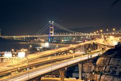 Stock Photo of night scenes of highway bridge in hong kong.