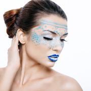 Beautiful woman in a fantastic makeup Stock Photos