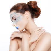 Stock Photo of Beautiful woman in a fantastic makeup