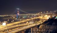 Stock Photo of highway and bridge at night