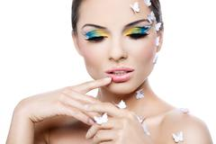 A beautiful woman with a fantastic make-up and styling - stock photo