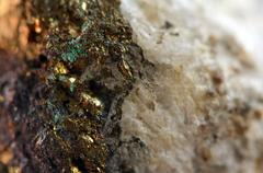 golden gem and crystal background. macro - stock photo