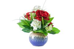 Stock Photo of isolated beautiful red and white roses bouquet in blue vase